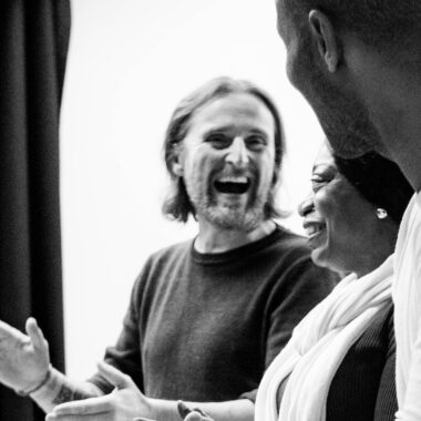 Three Citz Members laugh in a workshop