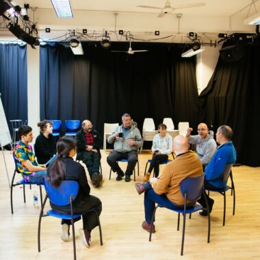 A workshop taking place in Cardboard Citizens' main rehearsal space