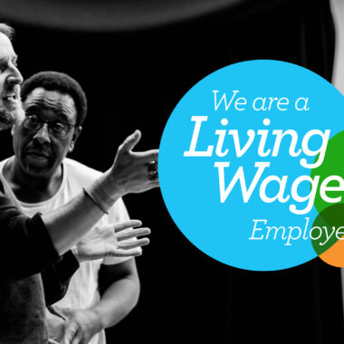 A black and white photograph of a Citz workshop participant and Tony Cealy, the workshop leader, overlaid with the Living Wage UK logo